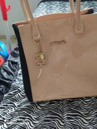 Vendo bolsa da petite jolie nova