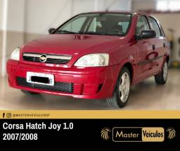 Corsa Hatch Joy 1.0, financiamos até 100%