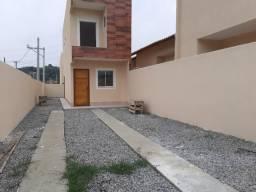Linda casa duplex de 2 suítes/quintal/ garagem 2 veículos em São Vicente -B. Roxo