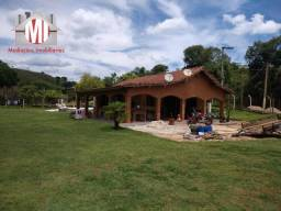 Excelente chácara com 02 casas, lago, córrego, pomar, baias, à venda em Pinhalzinho/SP
