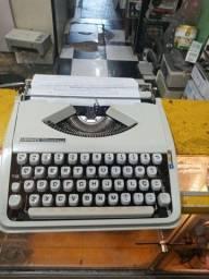 Máquina de escrever Olivetti importante portátil herme beby