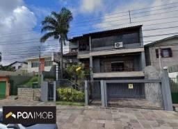 Casa com 4 dormitórios para alugar, 550 m² por R$ 9.800,00/mês - Vila Jardim - Porto Alegr
