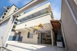 Sobrado com 4 dormitórios à venda, 182 m² por R$ 720.000 - Tupi - Praia Grande/SP