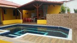 Casa para temporada em Mongaguá com piscina plataforma de pesca