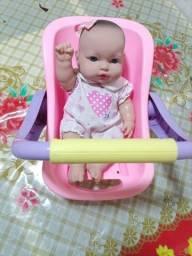 Título do anúncio: Boneca e bebê conforto novos. Os dois por 80.