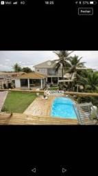 Casa com 7 dormitórios para alugar, 800 m² por R$ 13.000,00/mês - Vilas do Atlântico - Lau