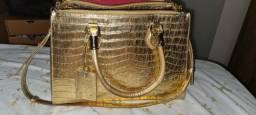 Bolsa dourada Schutz