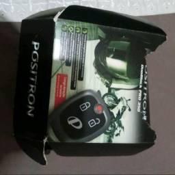 Um alarme Positron para moto com dois controle para vender barato