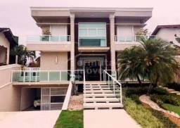 Casa Riviera com 700m², 7 suítes, 9 banheiros, 6 garagens, bar, área para churrasco, salão