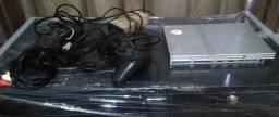 Título do anúncio: Playstation 2 Slim prata desbloqueado c/ 2 manetes paralela, cabo e fonte tudo ok