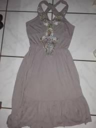 Vendo um vestido usado apenas uma vez ele tem um bolerinho n dar p mostra n fto