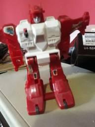 Brinquedo antigo robô Saltman
