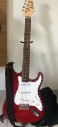 Guitarra + caixa amplificadora + acessórios