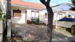 Excelente casa em condomínio localizada no distrito industrial em Cachoeirinha