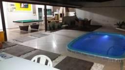 Casa com piscina bombinhas