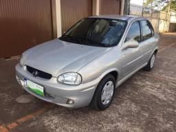Gm/corsa sedan classic 1.0 (vidro,trava, alarme e som ) - 2004