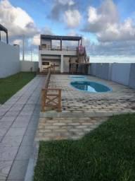Casa na quadra do mar três dormitórios a poucos min do centro de Torres