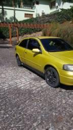 Astra hatch, 1999, amarelo.