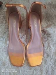 Vendo sandália com transparência usada uma vez Tam 39