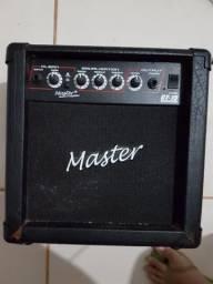 Guitarra Cort + Amplificador Master