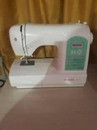 Máquina de costura singer estarlat