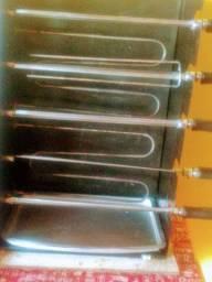 Vendo por 400.00 ou troco churrasqueira elétrica giratória com 5 espetos
