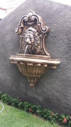 Fonte boca de leão em concreto para parede
