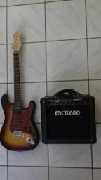 Guitarra e caixa amplificadora