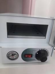 Vendo uma estufa semi nova