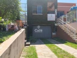 Título do anúncio: Casa com 4 dormitórios, piscina, pátio, em bairro central, Santa Maria/RS.