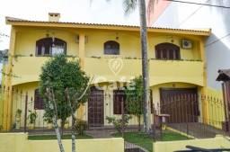 Título do anúncio: Casa 4 Dormitórios com 2 Salas, Lareira, pátio e Garagem para 3 carros