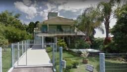 Casa alto padrão de frente para a Lagoa da Conceição no bairro Barra da Lagoa - Florianópo