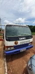 Caminhão GMC 7110 plataforma.