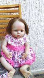 Bebê reborne com roupas e chupeta