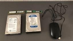 2 HDs 500 e 320 GB, 2 memórias RAM DDR3 4 e 2 GB, e um mouse da DELL