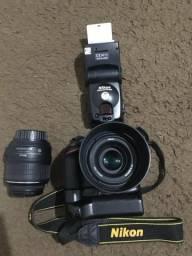Câmera nikon d3200. tel: * /maykon santos