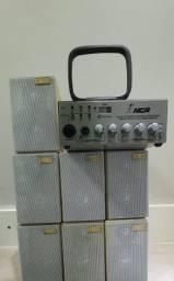 Amplificador NCA usado com 7 caixas de som
