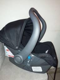 Bebê conforto preto pouco usado.