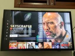 Smart tv Samsung 32 polegadas com lista horizontal de cor azul na tela