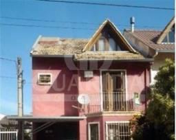 Título do anúncio: Casa em Condomínio para comprar no bairro Guarujá - Porto Alegre com 3 quartos