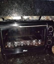 Vendo forno elétrico muito bom.. conservado tamanho médio