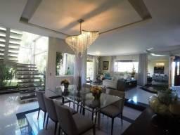 Casa com uma Arquitetura Moderna, 5 quartos sendo 3 suítes, 5 vagas, bairro Trevo Pampulha