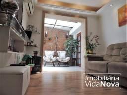Título do anúncio: Apartamento de 2 dormitórios, térreo, reformado, com pátio, à venda no bairro Alto Petrópo