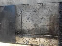 Portão de ferro com chapa