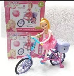 Boneca que anda de bicicleta a pilha 50,00