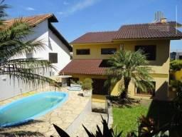 Vendo casa residencial próximo ao Shopping Iguatemi em Porto Alegre