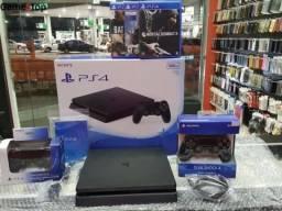 PlayStation 4 Slim 01 TB Modelo Novo/Aceitamos Cartões (Garantia de 01 ano da GameStop)