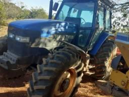 Trator New holand mais grade 14x32 pego camionete