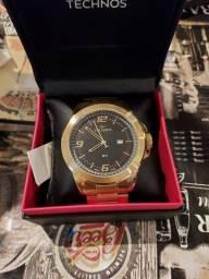 Título do anúncio: Relógio technos dourado zero nota e garantia  aceito cartao