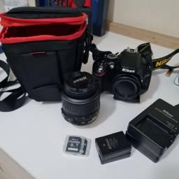 Título do anúncio: Câmera Nikon D5100 + Lente 18/55 + 3 baterias + Bolsa para lente + Bolsa Câmera